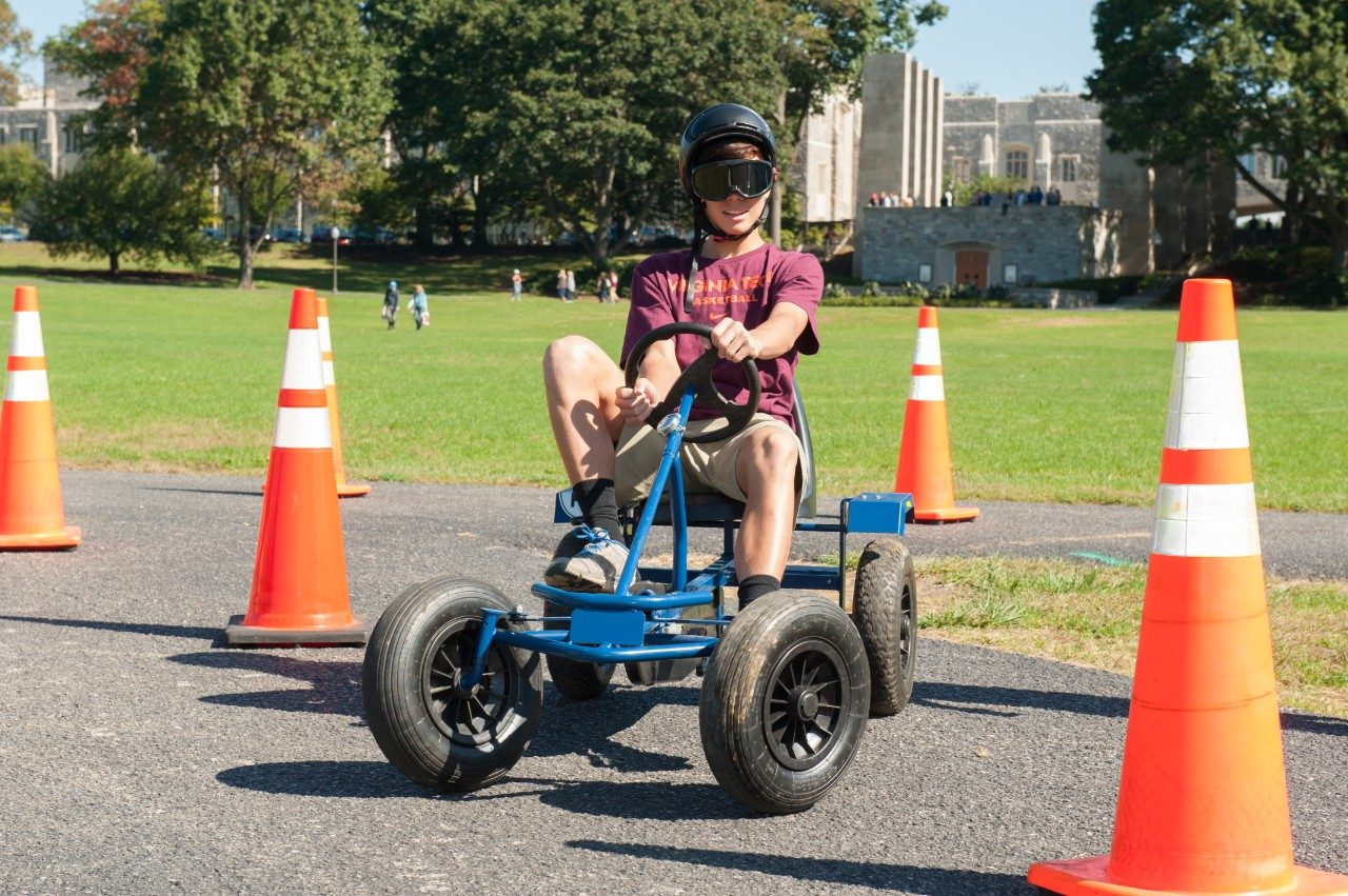 A participant uses a Drunk Goggle Cart.