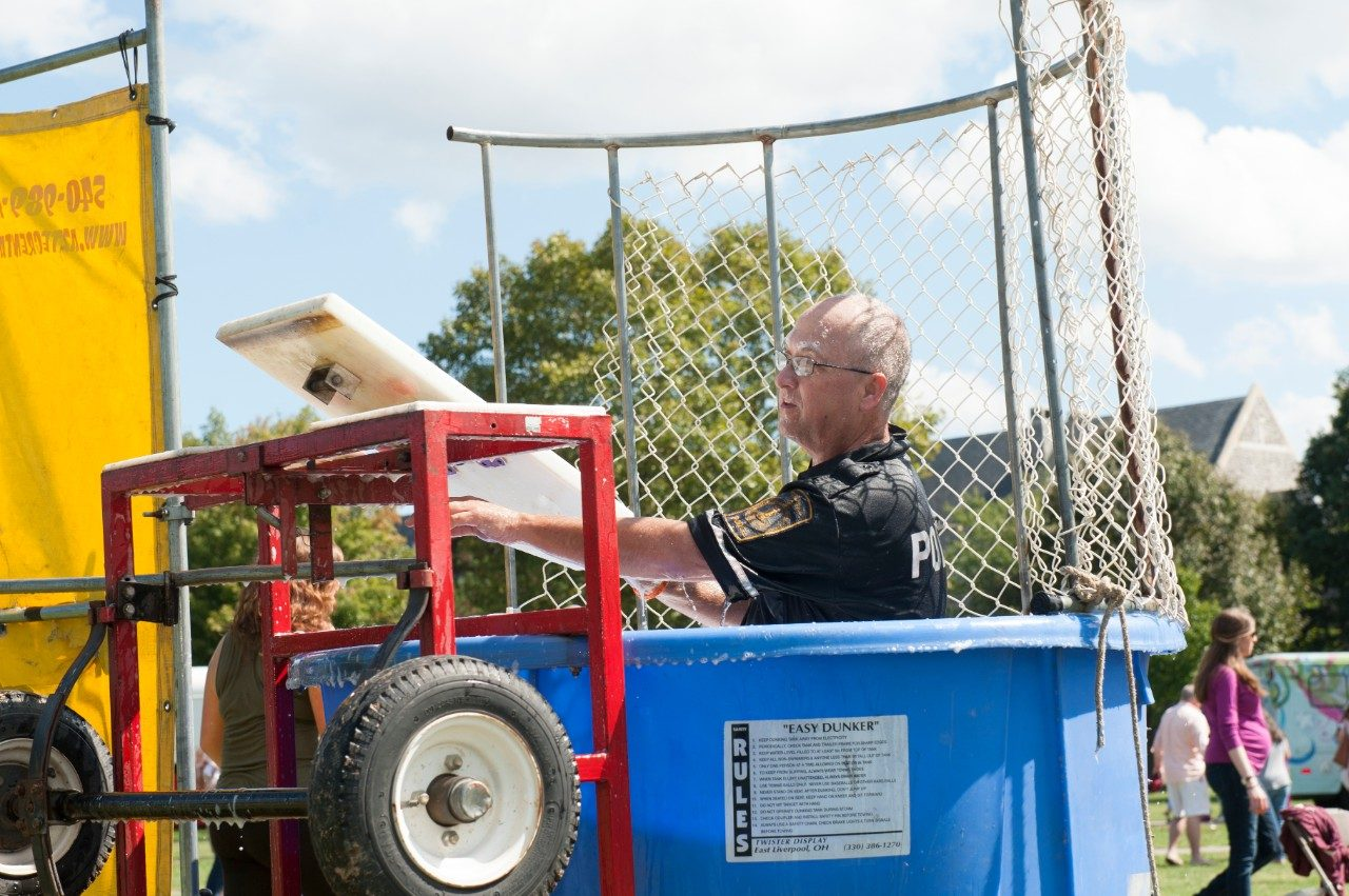 An officer prepares to be dunked.