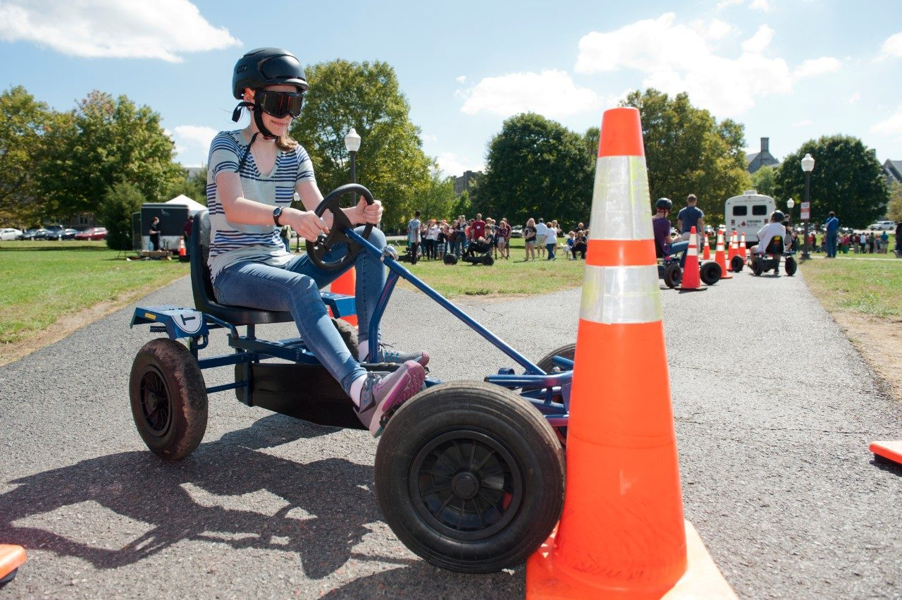 A participant crashes into a traffic cone while using a Drunk Goggle Cart.