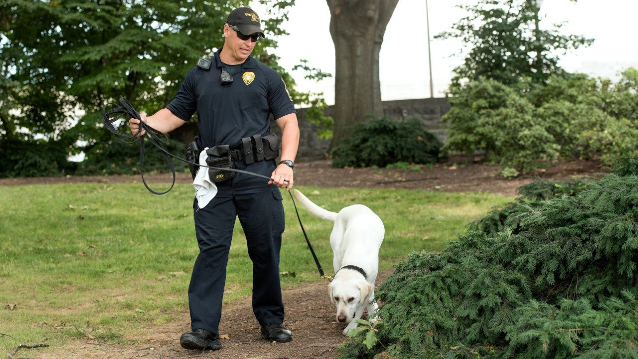 Officer Robert D. Ogle with K9 Toro, a new sniffer dog for the police department.